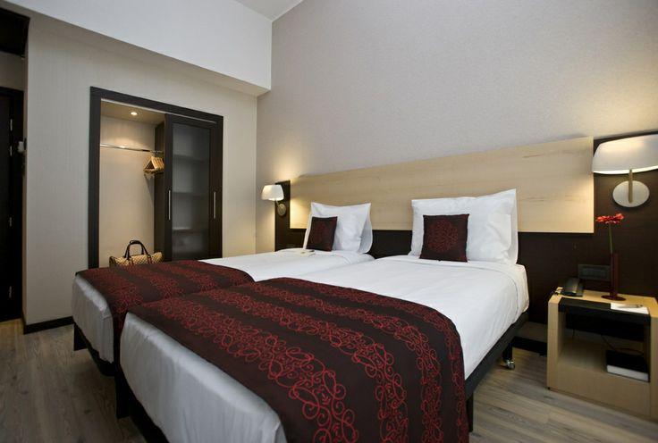 Una confortevole stanza dell'Hotel Parlament di Budapest