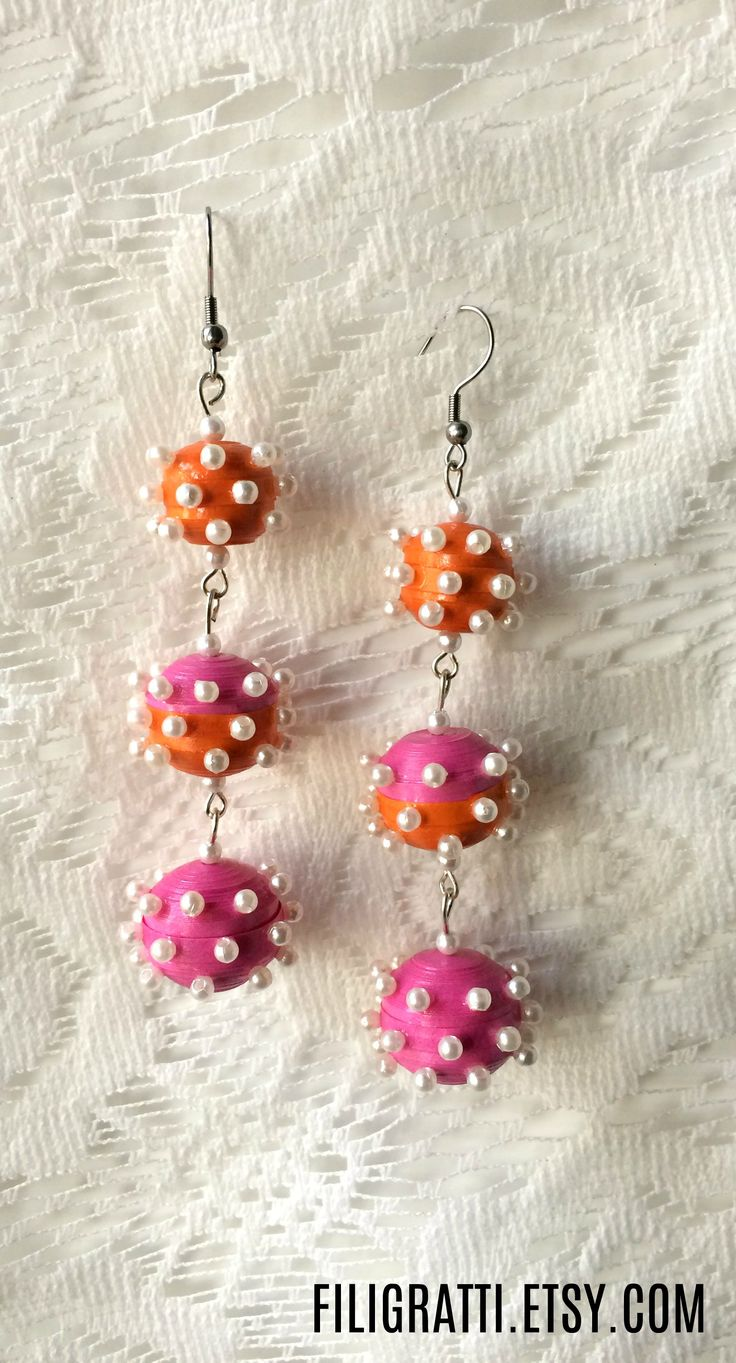 Make a style statement with these triple ball earrings. They are colorful & trendy, they will surely put you in the spotlight. #BallEarrings, #StatementJewelry, #stylestatement, #BallDropEarrings, #LightweightEarrings