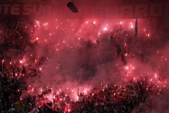Fans of Independiente Santa Fe cheer for their team during the Colombian First Division 'League Postobon' soccer championship against Deportivo Pasto in Bogota July 15, 2012. Santa Fe won the Colombian league championship.