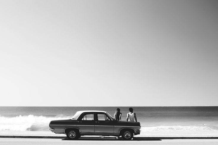 Holden HR sedan. Dawn Patrol surf check from the Kenoath lookbook. www.kenoath.com.au #holden #surf #surf vehicle #couple #vintage