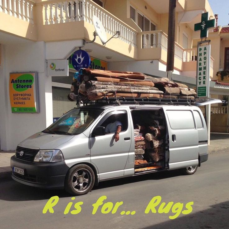 R is for rugs sold in the back of a transit van in Lardos