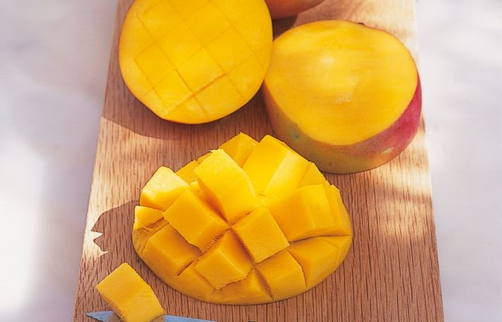 A mango is always rather awkward to prepare, but first you need to check that it's ripe. Colour is not an indication: the skins are variously green, red, yellow-orange or even vaguely purple. As with an avocado you need to hold the fruit in your hand and feel a 'give' or softness when you exert a little pressure. Smell, too, can help you – the riper it is, the heavier the perfume. The best way to start is to place the mango on a flat surface (I often use a dinner plate to catch t...