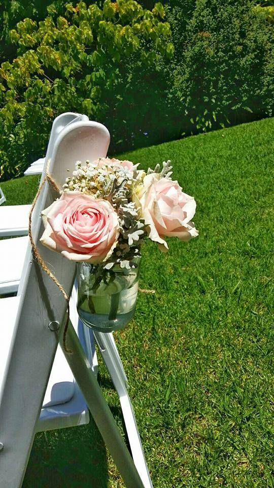 Rustic, vintage wedding. Roses, Baby's breath. Hessian, Burlap. Oil lamps.Event planner   Wedding planner   Florist   Floral designer   Cape Town