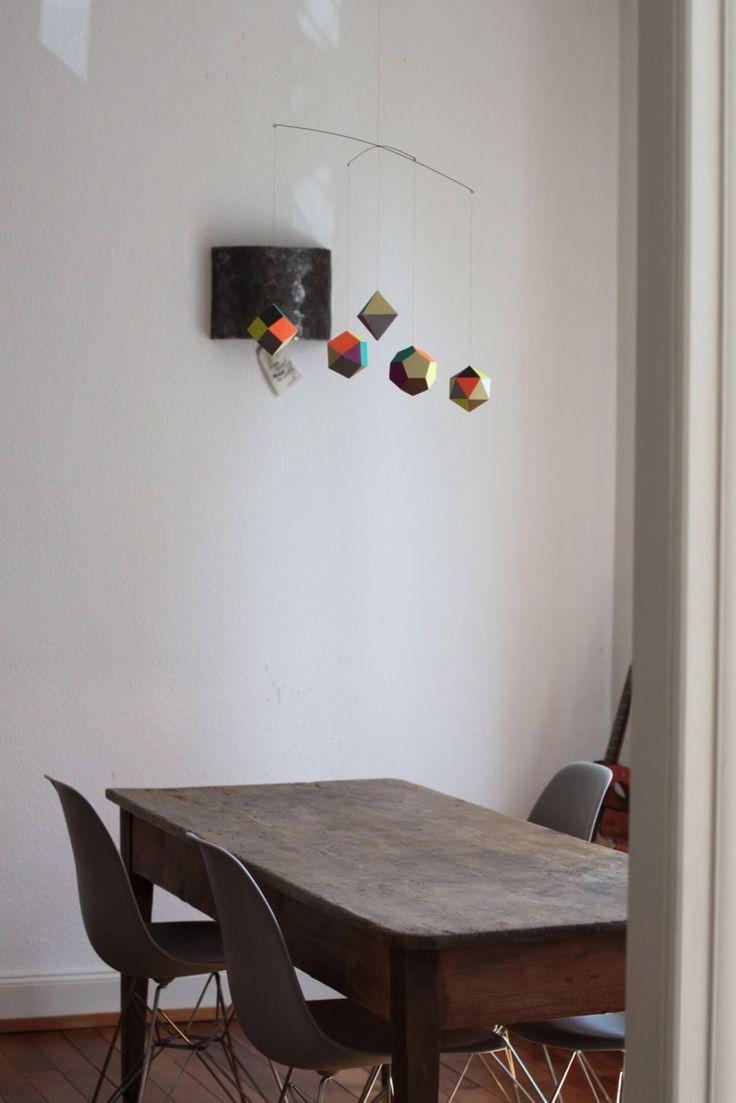 rustic table + modern chairs // hanging mobile = bonus