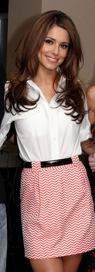 Everything about her is so polished and pretty.  Love her hair, the skirt, the belt, makeup...all of it!