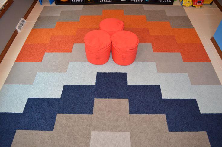 The floor in Brady's playroom —56 carpet tiles from Flor.com. Flor playroom carpet tiles in a chevron pattern. Blue, light blue, grey, orange Flor tiles.