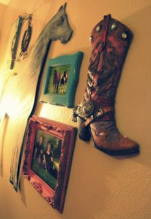 a wall with frames painted the bright colors she likes with western themed photos or drawings all different sizes