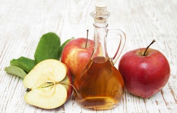 Apple Cider Vinegar and Apples on Table