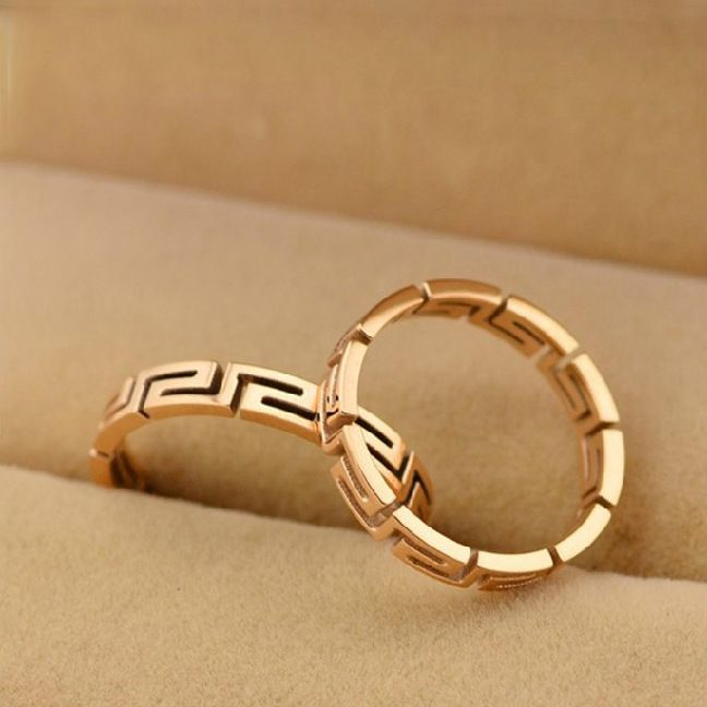This statement ring is finely polished and features a unique graphic design.
