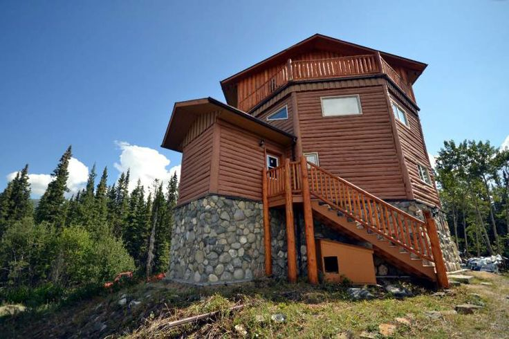 WHITEHORSE REAL ESTATE | Lot 1089 Lewes Lake, 4 bed and 4 bath, Log Home | Built in 2000. The only property east of Lewes Lake Rd. located approx. 40km from Whitehorse, this Octagon shaped, 4-story log home sits on 15 acres w/spectacular views! Surrounded by pristine wilderness and a nearby creek, this 2,800 sq. ft. home is your ideal country residential property. Main floor houses laundry & utility rooms, a large guest bedroom w/ensuite.
