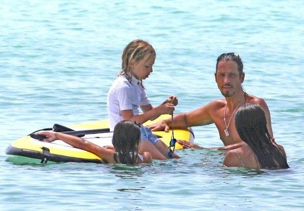 Soundgarden frontman, Chris Cornell, his wife Vicky Karayiannis and their children Toni and Christopher play on a paddle board while on a family vacation in Miami Beach.