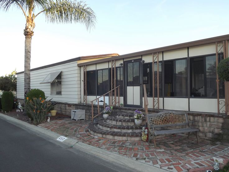 Triple wide with enclosed porch.  $45,000 Lake Los Serranos senior mobile home park in Chino Hills CA