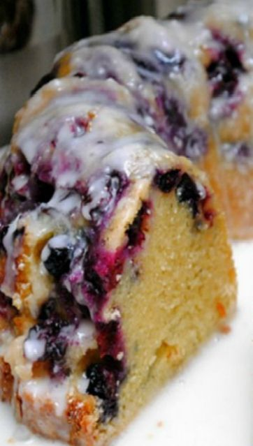 Blueberry Bundt Cake - Almost more berries than cake in this yummy recipe! The lemon glaze is perfectly tart-and-sweet!!