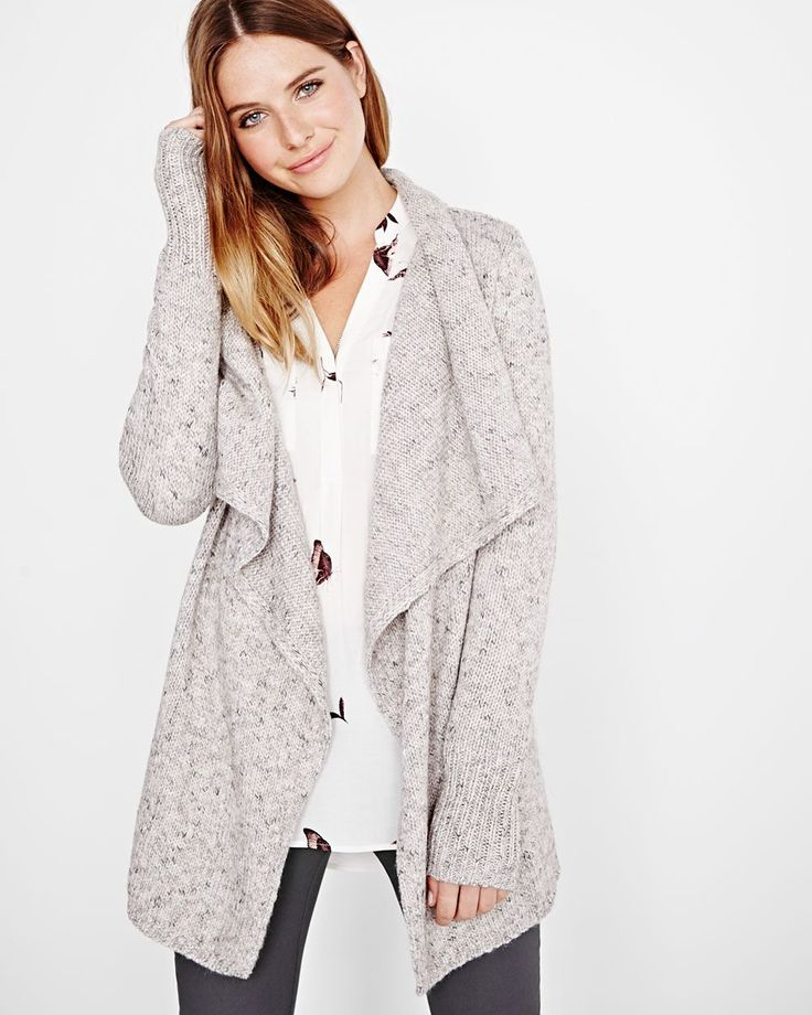 Great for running errands or keep warm at the office, this flattering cardigan offers a longer length and draped effect at the front, finished with a hook and eye closure.<br /><br />- Long sleeve<br />- Ribbed cuffs<br />- Hairy yarn<br />- Hook and eye closure