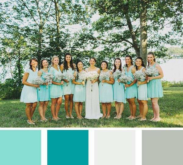 Aqua wedding colors: A little bit of teal and a lot of robin's egg blue - this wedding is coolly summery. A groom in a light grey suit is the perfect finishing touch for this color palette.
