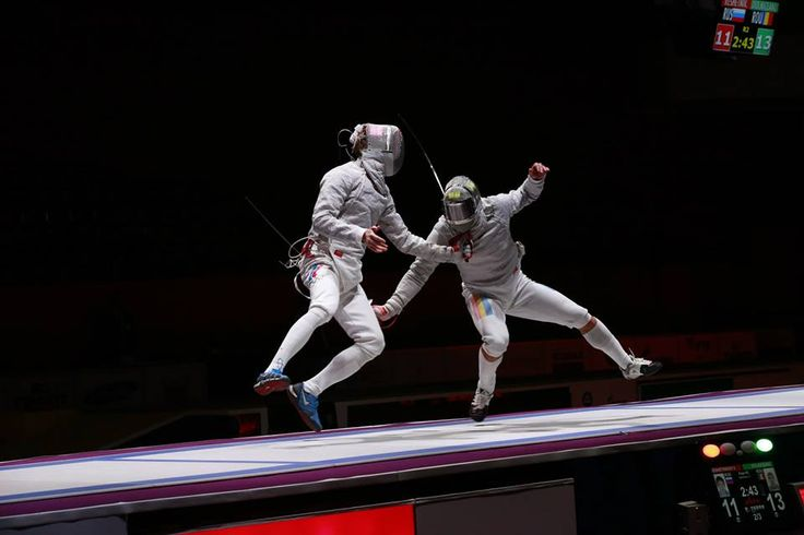 Flunging. I can't even.  [ID: two sabre fencers flunging and hitting each other.] Veniamin Reshetnikov (left) against Tiberiu Dolniceanu, at the World Combat Games