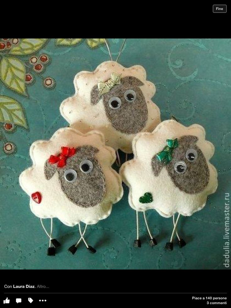 Felt sheep with a ribbon