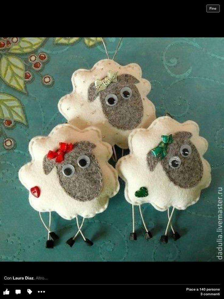Felt sheep with a ribbon