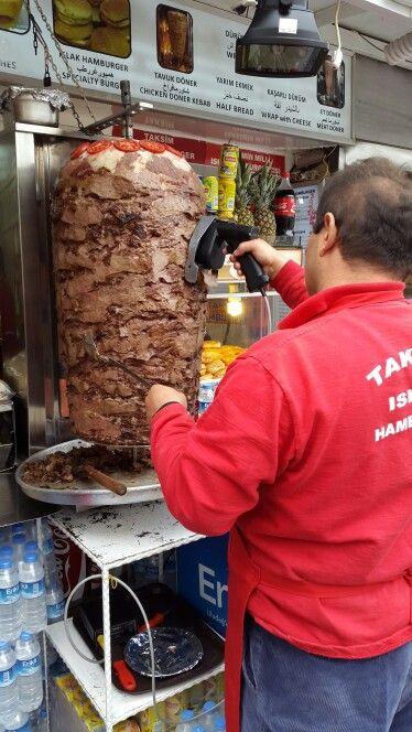 Mechanically slicing shawarma/doner on Istanbul streets