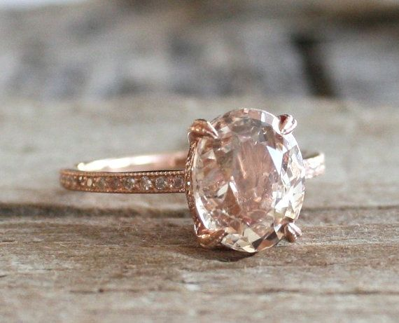 My future engagement ring  https://www.etsy.com/listing/217874374/40-ct-oval-peach-champagne-solitaire