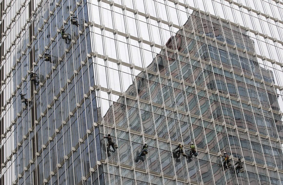 Workers clean the windows of an office building in Seoul, South Korea, Tuesday, May 1, 2012.: Window, Offices Building, Office Buildings
