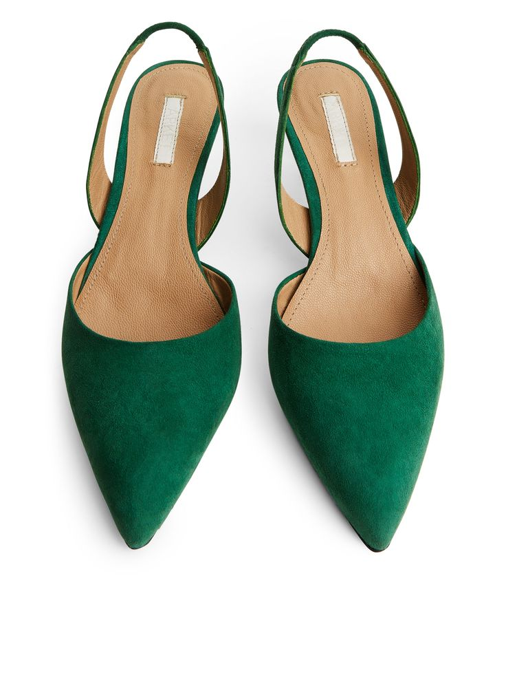 250022-564 - Suede Slingback Pumps. Designed with a pointy toe and a comfortable kitten heel, this slingback style is made of premium suede that has undergone a metal-free tanning. Covered elastic at back. #ARKET
