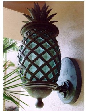 I actually like this!  Pineapple outdoor fixtures