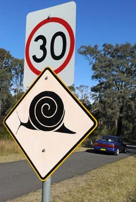 The ultimate animal crossing sign: slow down for endangered Cumberland land snails -- at Mount Annan near Sydney, Australia