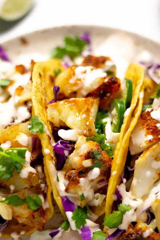 Baked Fish Tacos With Chipotle Lime Cream Sauce Recipe Fish Tacos Recipe Delicious Seafood Recipes Baked Fish Tacos