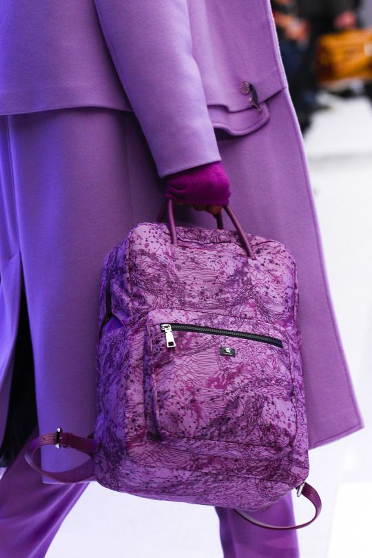 Staying warm in winter in a purple coat & gloves and hand bag.