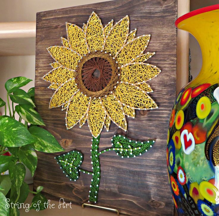 Most popular and Colorful Sunflower String Art. Pops off the Dark Walnut Stained Wood Board. See this String Art Kit on Etsy at String of the Art