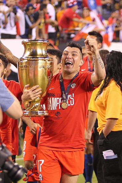 #COPA2016 #COPA100 Gary Medel of Chile celebrates with the trophy after winning the championship match between Argentina and Chile at MetLife Stadium as part of Copa...