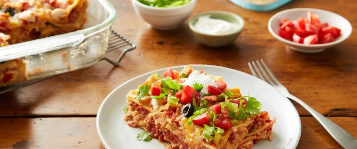 Mexico meets Italy, with south-of-the-border favorites like refried beans, taco sauce, and cilantro appearing in a cross-cultural chicken lasagna.