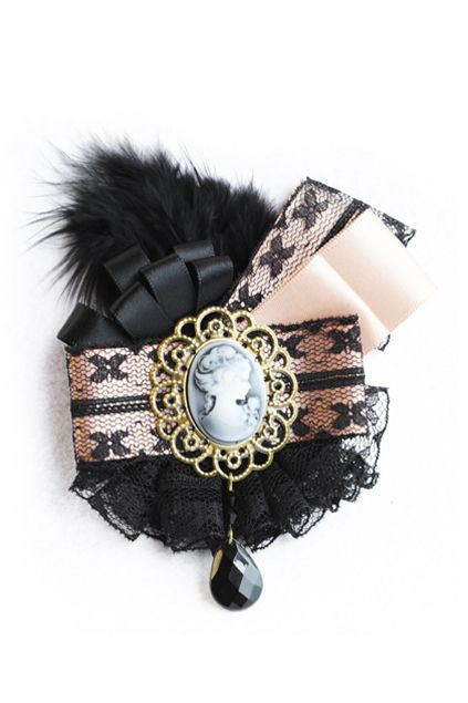 "Feather ""Fake Diamonds"" Brooch from Romwe - Lace, ribbons, cameo, a tear drop bead and a feather why not; Both complex enough to look like a treasure and monochromatic enough to not overwhelm the senses."