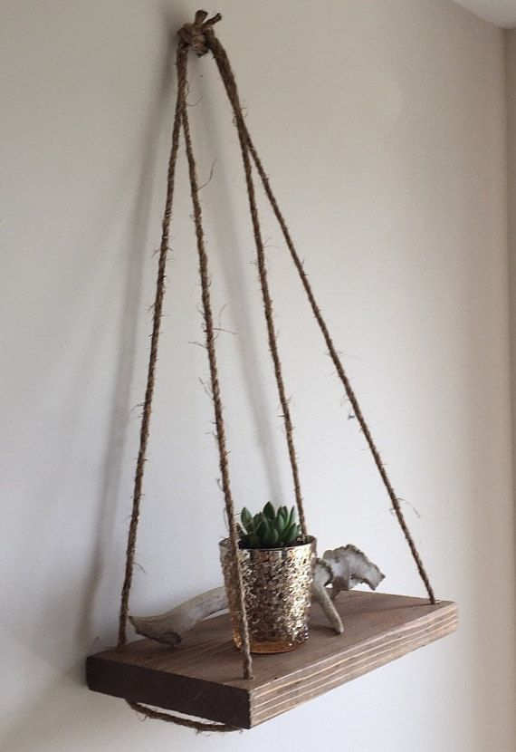 This Reclaimed Wood Hanging Shelf is perfect to feature plants or other decorative household items! Made from reclaimed wood and natural jute twine