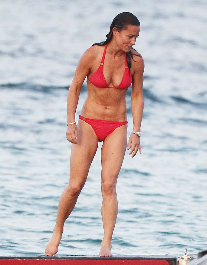 Pippa Middleton looked red hot in a skimpy bikini while on vacation with her family.