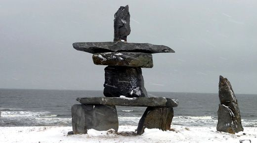 The large inukshuk on the shores of Hudson Bay in Churchill, Manitoba, Canada.