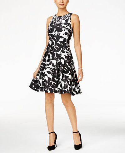 Pop on this graphic-print floral dress from Ivanka Trump for delightful day style that's both polished and feminine.   Shell and lining: polyester   Hand wash   Imported   Embellished scoop neckline  