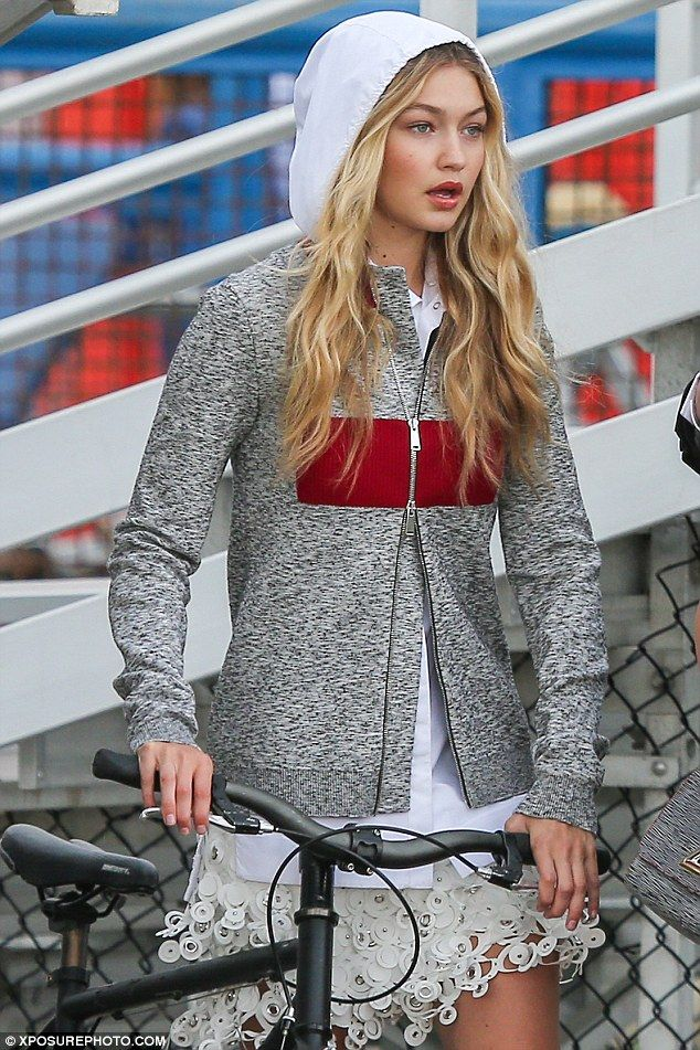Chic: Gigi, the daughter of RHOBH star Yolanda Foster, rocked a slate grey jacket over a w...