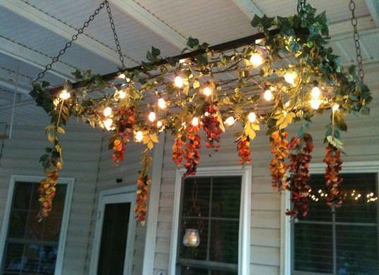 Hang repurposed bed springs from the porch and make a DIY outdoor lighting scheme