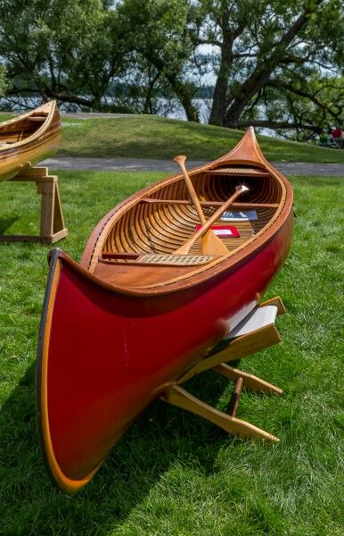 Red Wood and Canvas Canoe on the Green at Paul Smith's College in the Adirondacks.