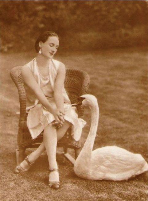 In quiet conversation, Anna Pavlova with her swan, Jack.