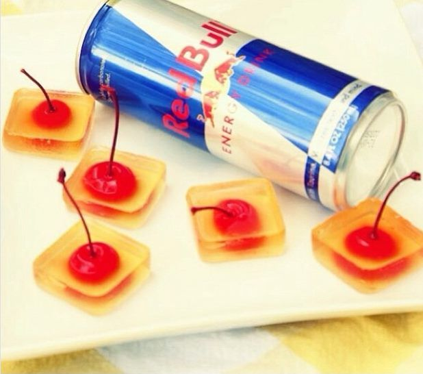 Vodka Red Bull Jello Shots - 1 cup Vodka, 1 cup Red Bull, 1/2 packet gelatin, cherries with stems and ice trays. Mix and pour mixture into ice trays (filling to make shot size you desire), refridgerate till gelatin sets. Shared from Google