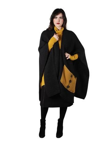 Delicious and warm this chunky wrap will keep you covered through the Winter. Lambswool and Nylon blend.