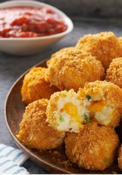 VELVEETA Potato Bites – These crunchy, bite-sized potato balls make the perfect party appetizer recipe.
