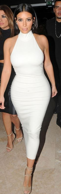 Who made  Kim Kardashian's white turtleneck dress and suede tan sandals that she wore  in Abu Dhabi?