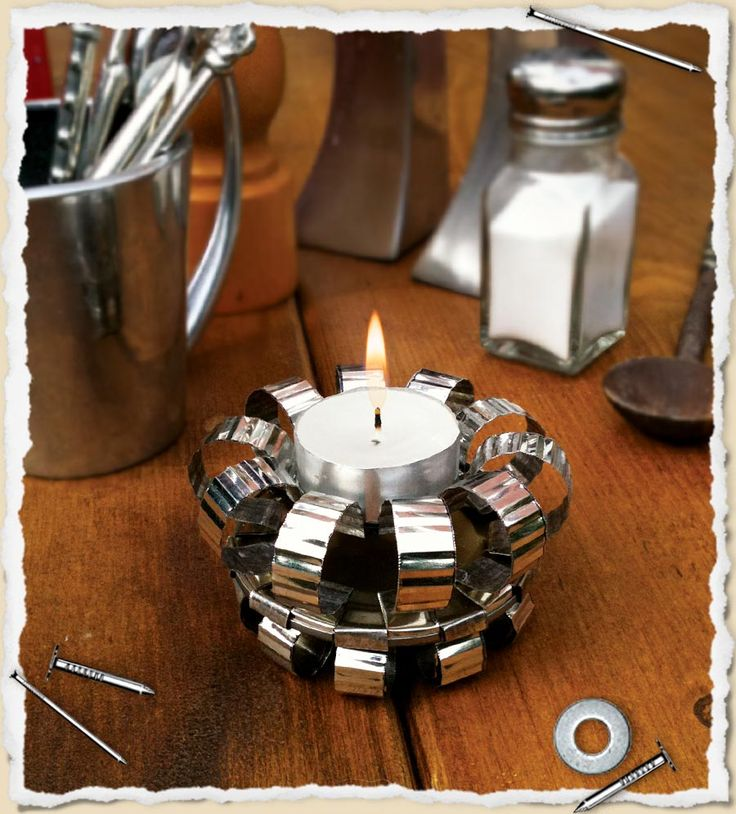 Elegant 'tin can' tea light holder. This is a great upcycling site. Keep for the boys for this summer.