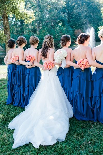 Love the idea of an image of the back of the bridal party -details that you don't want to forget on such lovely dresses - loyal blue bridal party surrounding their bride arm in arm