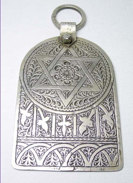 Africa | An extremely large Jewish Moroccan Silver Khamsa, with intricate engraving of the Rose of Essaouria and wonderful patina | c. 1930 – 1940 | Origin; Essaouria, Morocco
