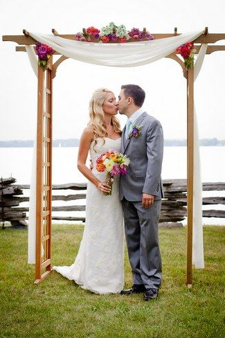 Colorful Rustic Vermont Outdoor Wedding Arch. See more here: Colorful Rustic Vermont Outdoor Wedding | Confetti Daydreams ♥  ♥  ♥ LIKE US ON FB: www.facebook.com/confettidaydreams  ♥  ♥  ♥ #Wedding #RusticWedding #RealBride